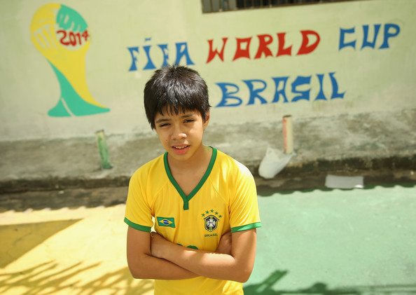 Cute Brasil boy in football shirt